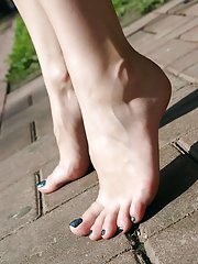 Of course the legs leading to her lovely feet are smooth and delicious, too! Alena has this understated perfection about her, and she does know it can